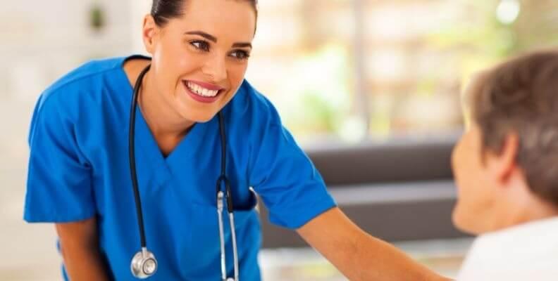Smiling Nurse Reassuring Patient