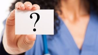 nurse_holding_question_mark_card