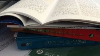 Stack_of_Nursing_Research_Texts
