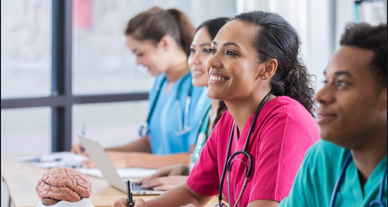 Young group of nursing students sitting in class listening