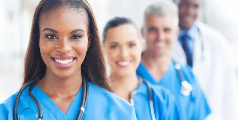 Registered nurse in front of additional medical staff