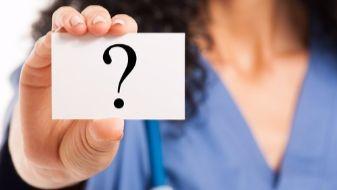 nurse_holding_question_mark_card